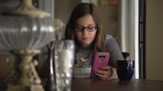 Pre-teen girl on mobile phone video