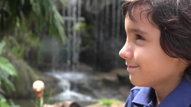 Preteen Hispanic Boy at Waterfall video