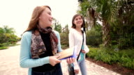 Preteen students walking and talking together after school video