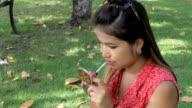 Pretty Asian Girl Applies Lip Gloss video