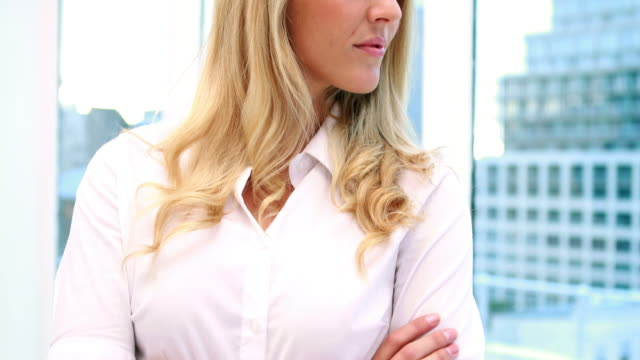 Pretty blonde businesswoman smiling at camera video