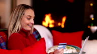 Pretty blonde buying her christmas gifts online video