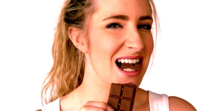 Pretty blonde eating a chocolate bar video