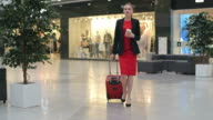 Pretty Business Traveler Pulling Suitcase video