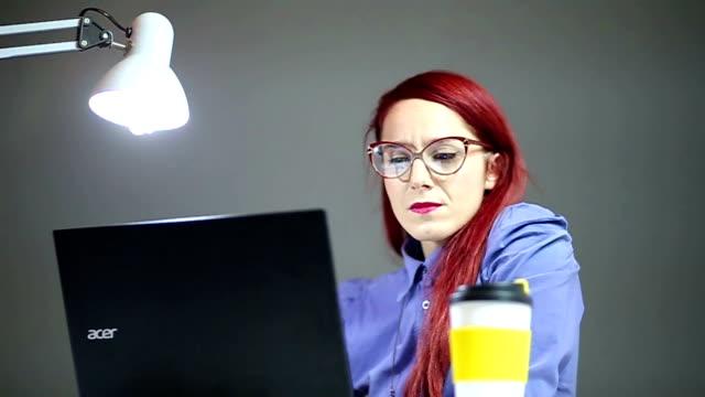 Pretty Businesswoman in Big Eyeglasses Looking at Laptop video