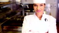 Pretty chef smiling at camera video