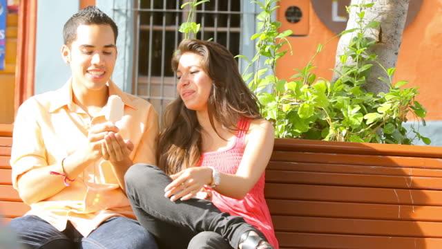 Pretty couple share some ice cream video