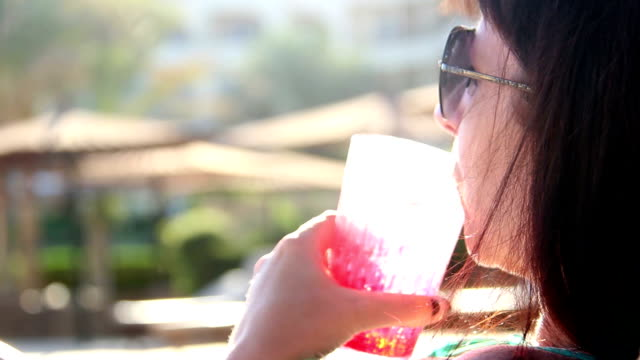 Pretty Female Drinking Fresh Cocktail Near Pool At Summer Resort video