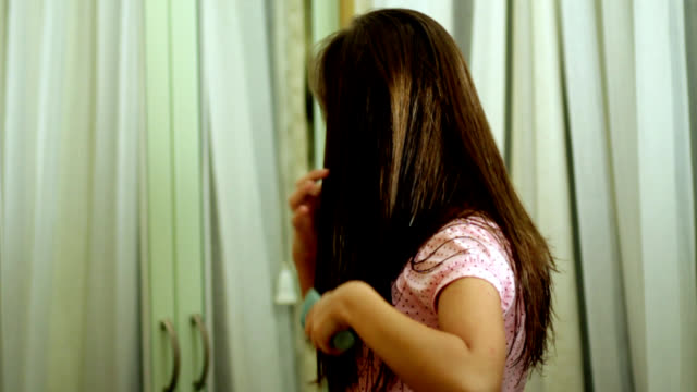 Pretty girl brushing hair video