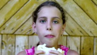Pretty girl eats slice of white bread video