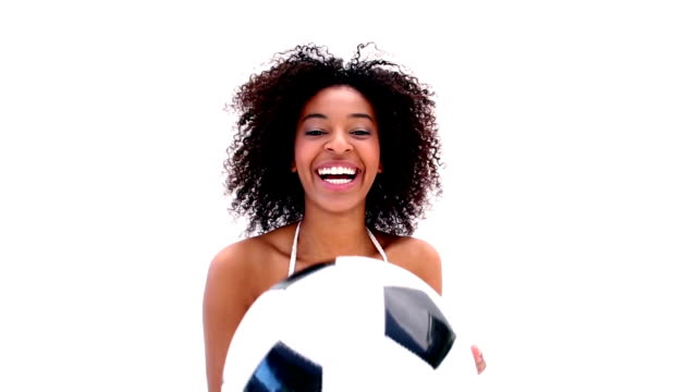 Pretty girl in bikini holding football video