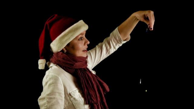 Pretty girl in red Christmas Santa pours confetti video