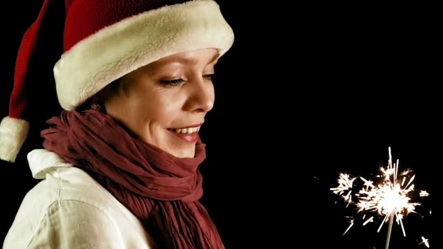 Pretty girl in red Christmas Santa with Sparklers video