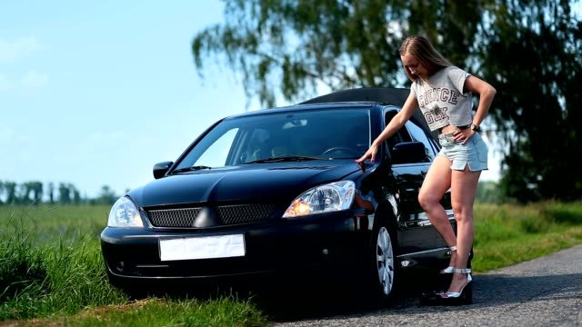 Pretty girl inflating car tyre with foot pump video