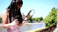 Pretty girl listening to music and drinking coffee outdoors video