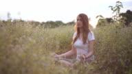 Pretty Girl Meditating in Park video