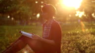 Pretty girl reading book in the park video