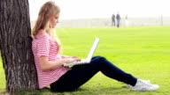 Pretty girl using her laptop video