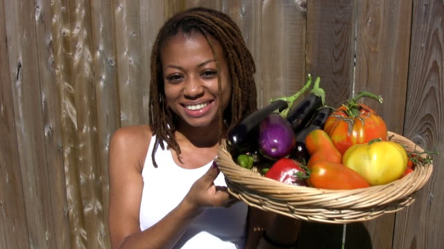 Pretty girl with homegrown vegetables. video