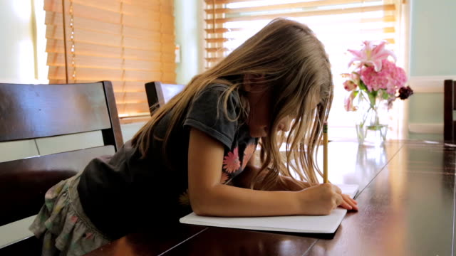 Pretty little girl writing video