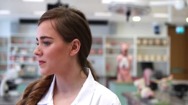 Pretty medical student smiling at camera video