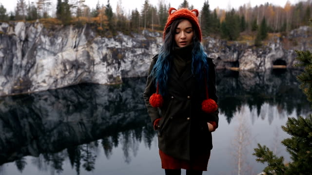 Pretty nice girl enjoy beautiful lake view from the hilltopl and good weather in Karelia. Around the rocks video
