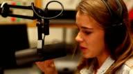 Pretty student presenting a radio show video
