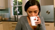 Pretty woman drinking by white cup video