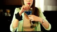 pretty woman drinking cocktail in nightclub video