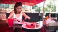 Pretty woman enjoying the taste of grilled steak in restaurant video