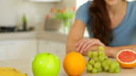 Pretty woman looking at selection of fruit video