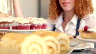 Pretty woman preparing plate of cakes video