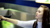 Pretty woman provides passport control in airport in day time video