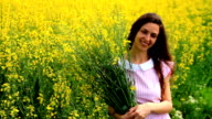 Pretty Woman Relaxing Holding Yellow Herbs on Summer Field HD video