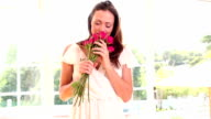 Pretty woman smelling bouquet of roses video