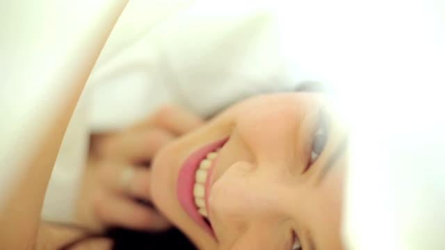Pretty woman under the bedsheet video