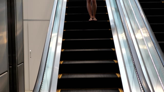 Pretty Young Brunette Woman Coming Down The Escalator video
