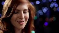 Pretty young red haired woman smiling video