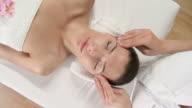 HD CRANE: Pretty Young Woman Enjoying Relaxing Facial Massage video