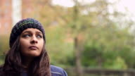 A pretty young woman looks thoughtfully upward. video
