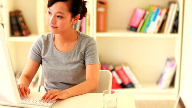 pretty young woman working with computer in home video