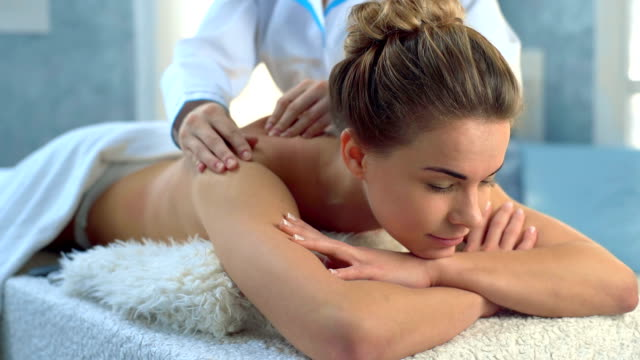 Pretty young women relaxing in the spa salon video