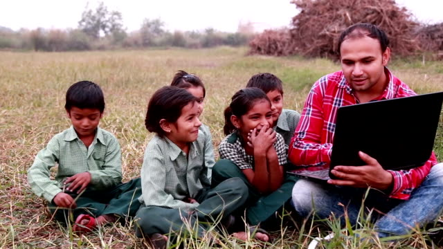 Primary School Students with Teacher In Class Using Laptops outdoor video