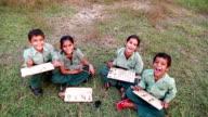 Primary school students writing wearing uniform video