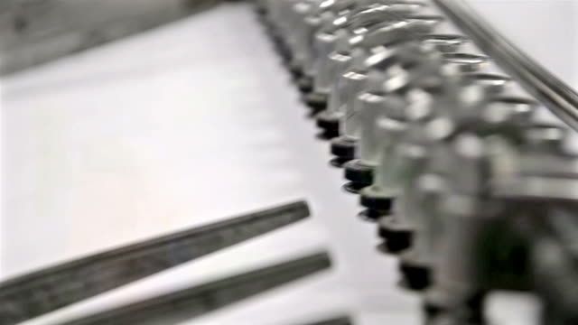 Print sheets are loaded in commercial offset printing press machine, HD Stock Video LOOP video