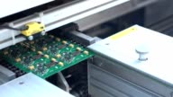 Printed circuit board leaves on the line. SMT Printed circuit board video
