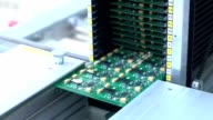 SMT Printed circuit board. Printed circuit board leaves on the line video