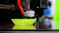 3D printer working and creating an object from the hot molten plastic video