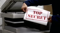Printing a top secret text document on printer machine video
