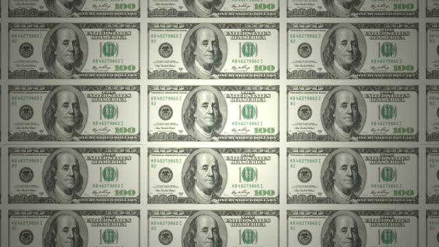 Printing bills of american one hundred dollars rolling, cash money video